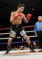 October 11, 2013.  Daniel Franco (black & yellow trunks) defeated Manuel Romero in a Lightweight bout during the Central Coast Boxing Championship at the Chumash Casino in Santa Ynez,California on October 11, 2013. .(Credit Image: © John Pyle/ZUMAPRESS.com)