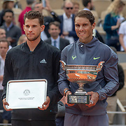 PARIS, FRANCE June 09. Dominic Thiem of Austria with the runners up trophy and Rafael Nadal of Spain with the winners trophy on Court Philippe-Chatrier after the Men's Singles Final at the 2019 French Open Tennis Tournament at Roland Garros on June 9th 2019 in Paris, France. (Photo by Tim Clayton/Corbis via Getty Images)