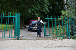 © Licensed to London News Pictures. 24/08/2020. London, UK. A police officer at the gages of St James Park, Walthamstow, East London as detectives launch an investigating following the discovery of a man's body. Police were called by a member of the public at approximately 13:40hrs to St James Park, E17, after a person was found unresponsive. A man, aged in his thirties, was pronounced dead at the scene. Photo credit: Dinendra Haria/LNP