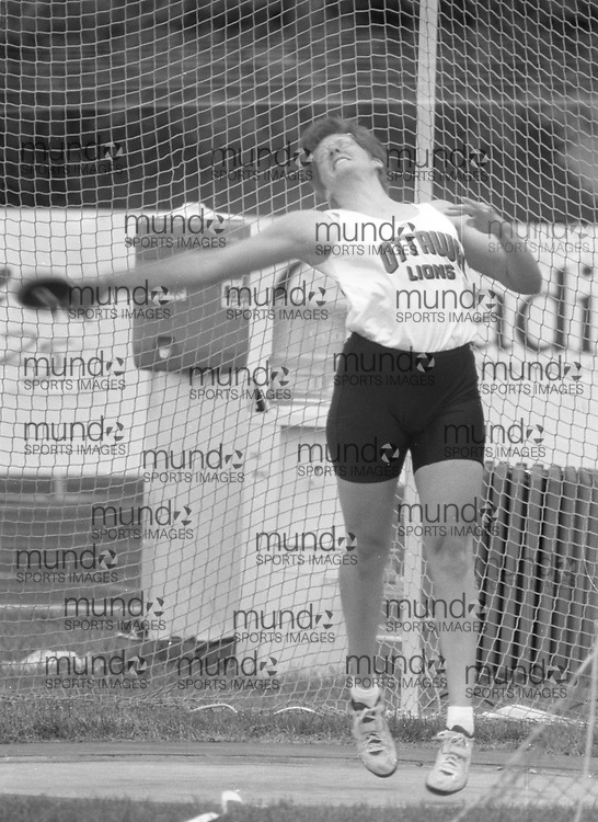 ******This is an unprocessed scan from the negative. You can buy it as is and clean it up yourself, or contact us for rates on providing the service for you. *******<br /> <br /> (Montreal, Canada---18-21 June 1992) Cathy Griffin throwing the discus at the 1992 Canada Track and Field Olympic Trials as the complexe sportif Claude-Robillard in Montreal. Photo 1992 Copyright Sean Burges / Mundo Sport Images.<br /> <br /> ******This is an unprocessed scan from the negative. You can buy it as is and clean it up yourself, or contact us for rates on providing the service for you. *******