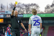 Yellow card for Wycombe Wanderers forward Alex Samuel (25) for his foul on Scunthorpe United defender Rory McArdle (23) during the EFL Sky Bet League 1 match between Scunthorpe United and Wycombe Wanderers at Glanford Park, Scunthorpe, England on 29 December 2018.