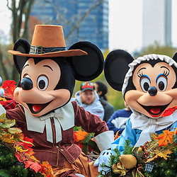 Philadelphia, PA, USA - November 24, 2016: Disney's Mickey and Minnie Mouse, dressed as pilgrims, ride in an open carriage at the Thanksgiving Day parade.
