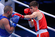 Gedminas Mindaugas of Norway (red) and Imre Balazs Bacskai of Hungary (bue) competing in the Men's Middleweight preliminaries during The Road to Tokyo European Olympic Boxing Qualification, Sunday, March 15, 2020, in London, United Kingdom. (Mitchell Gunn-ESPA-Images/Image of Sport)