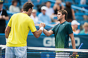 Argentina's Juan Martin Del Potro and USA's Ryan Harrison shake hands after their men's singles match at the Citi Open ATP tennis tournament in Washington, DC, USA, 1 Aug 2013. Del Potro won the match 6-1,7-5 to advance.