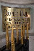 The entrance plaque of Drapers Hall livery company in Throgmorton Street, on 17th Juy 2017, in the City of London, England. The Drapers' Company is a Livery Company in the City of London whose roots go back to the 13th century, when as its name indicates, it was involved in the drapery trade. While it is no longer involved in the trade, the Company has evolved acquiring a new relevance. Its main role today is to be the trustee of the charitable trusts that have been left in its care over the centuries. The Company also manages a thriving hospitality business. The first Drapers' Hall was built in the 15th century in St Swithin's Lane.  It bought a Hall on the present site in Throgmorton Street in 1543 from King Henry VIII for £1,200 about £350,000 in today's money. The Hall that the Company purchased from King Henry VIII in 1543 had been the private residence of Thomas Cromwell, Earl of Essex until his execution in 1540, when it was confiscated by the Crown.