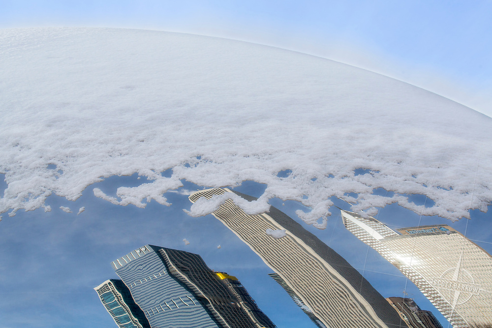 The Chicago skyline's Loop area reflected in the surface of the Cloud Gate in Millenium Park.