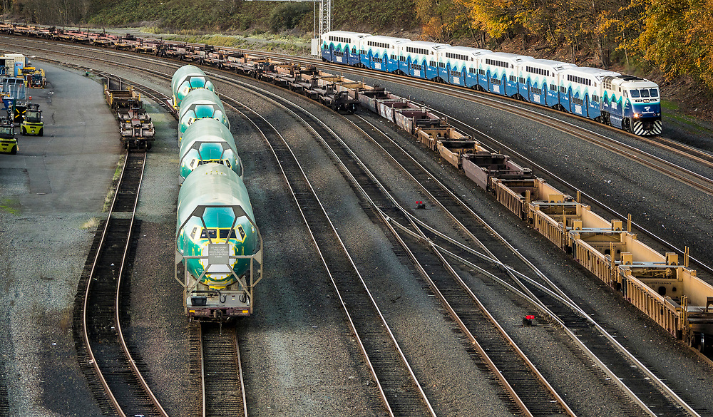 Boeing 737 fuselages on railroad cars near Seattle, Washington, for delivery to the Boeing Renton Assembly Plant in Renton, Washington, US, 11/06/2018.  Right, a passing Sound Transit Sounder commuter train.