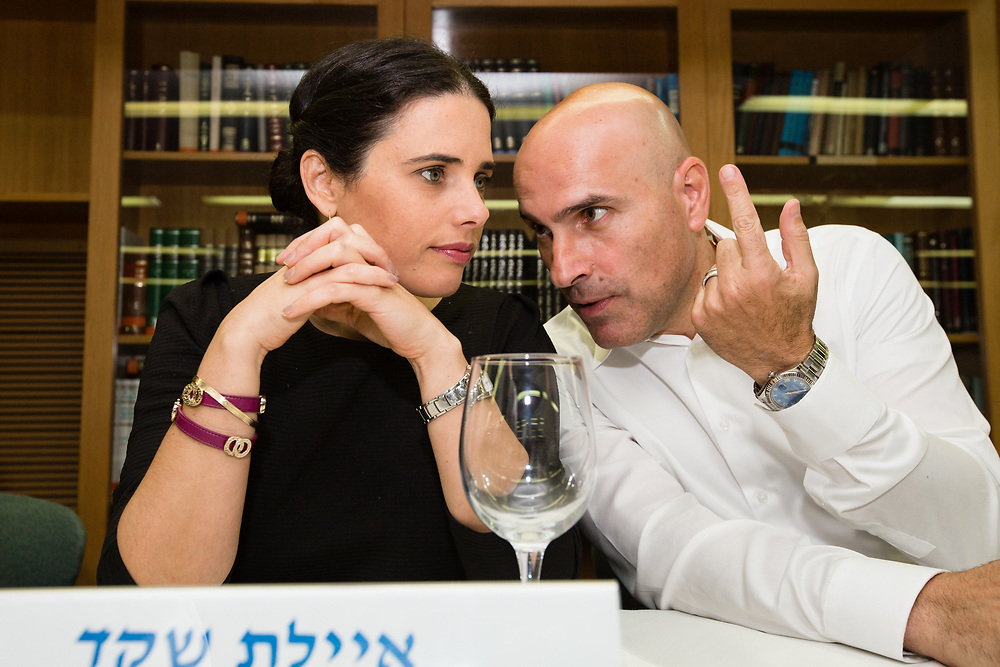 Israeli Attorney Effi Naveh, chairman of the Israel Bar Association (R) talks with Israeli Justice Minister Ayelet Shaked, at the Israeli Bar Association's offices in Jerusalem, Israel, on July 10, 2016.
