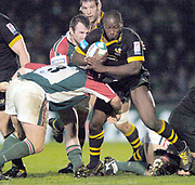 Wycombe. GREAT BRITAIN, 5th December 2004. Heineken Cup Rugby  London Wasps and Leicester Tigers,  Adams Park, ENGLAND, [Mandatory Credit; Peter Spurrier/Intersport-images].<br /> <br /> Wasps centre Ayoola Erinle, tackled by Julian white [No.3] and George Chuter [behind]