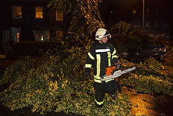 © Licensed to London News Pictures. 09/06/2014. Mülheim an der Ruhr, Germany. Fire brigade clear up debris. After a very hot day with temperatures reaching the mid 30 degrees centigrate, severe thunderstorms cause havoc in the Ruhr Area in Mülheim an der Ruhr and surrounding towns in North Rhine-Westphalia, Germany. Photo credit: Bettina Strenske/LNP