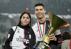 TURIN, May 20, 2019  FC Juventus' Cristiano Ronaldo (L) and his girlfriend Giorgina Rodriguez pose with the trophy during the trophy ceremony at the end of the Serie A soccer match between FC Juventus and Atalanta in Turin, Italy, May 19, 2019. FC Juventus sealed the title with a 2-1 victory over FC Fiorentina on April 20, 2019. (Credit Image: © Alberto Lingria/Xinhua via ZUMA Wire)