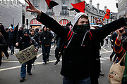 Anti capitalists / anarchists go on the rampage through central London on the back of the peaceful TUC protest march. The masked demonstrators ran a twisting route through the capital confusing the police and creating a situation which was very difficult to manage. The protesters attacked banks, shops and hotels, and the police in riot gear fought  face to face with them as they were pelted with ammonia, paint and fireworks loaded with coins.