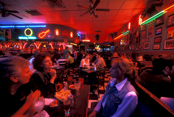 Stock photo of a group of people enjoying appetizers at a downtown Houston restaurant