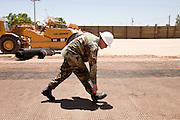 12 JUNE 2006 - SAN LUIS, AZ: Spc. Derrick Frame from the Utah Army National Guard works on a stretch of all purpose road on the US/Mexico border near San Luis, AZ, Monday. Fifty five members of the 116th Engineer Company, Combat Support Engineers, of the Utah Army National Guard are in San Luis, AZ, to build a fence and improve roads east of the San Luis Port of Entry on the US/Mexico border. The unit is the first of an estimated 6,000 US military personnel, almost all of them Army National Guard, who will be dispatched to the US/Mexico border by President Bush to help control immigration on the border. The Guardsmen will primarily build roads and fence and staff surveillance centers. They will not be engaged in first line law enforcement work.  Photo by Jack Kurtz