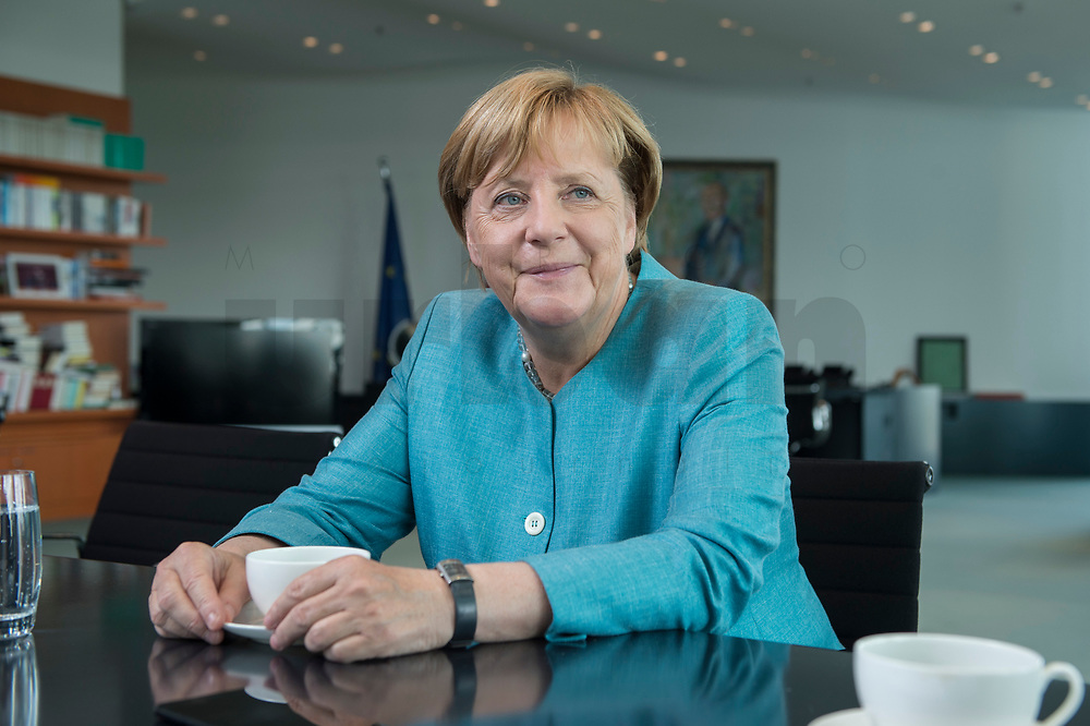 23 AUG 2017, BERLIN/GERMANY:<br /> Angela Merkel, CDU, Bundeskanzlerin, waehrend einem Interview, in Ihrem Buero, Bundeskanzleramt<br /> IMAGE: 20170823-02-003<br /> KEYWORDS: Büro
