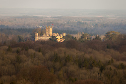 © Licensed to London News Pictures. 24/02/2014. Beacon Hill, Burghclere, Hampshire, UK. Highclere Castle, the set for the popular TV drama 'Downton Abbey' bathed in golden light shortly after sunrise this morning 24th February 2014. Photo credit : Rob Arnold/LNP