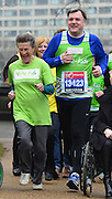 © Licensed to London News Pictures. 11/04/2013. Westminster, UK. 85 year old Iva Barr, the marathon's oldest female competitor joins Shadow Chancellor Rt. Hon Ed Balls MP at a photo-call to launch his second Virgin London Marathon Challenge, raising money and awareness for disabled children's charities Whizz-Kidz and Action for Stammering Children. Photo credit : Stephen Simpson/LNP