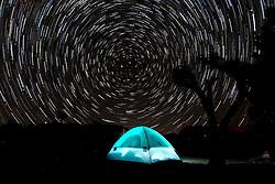 October 2, 2016 - Los Angeles, California, U.S - Star trails are seen above the Joshua Tree National Park in Twentynine Palms, California, October 2, 2016. (Credit Image: © Ringo Chiu via ZUMA Wire)