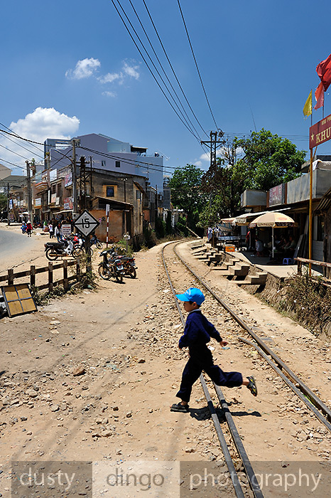 Child running across the railway tracks at Trai Mat, near Da Lat, Vietnam