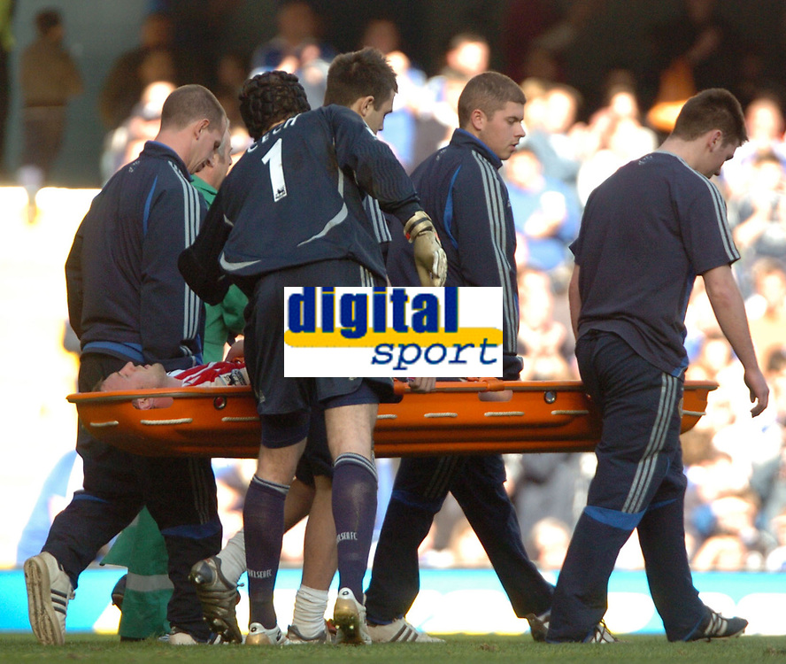 Photo: Tony Oudot.<br />Chelsea v Sheffield United. The Barclays Premiership. 17/03/2007.<br />Rob Hulse of Sheffield United is stretchered off with a suspected broken leg after colliding with Petr Cech.<br />Petr Cech consoles Hulse as he leaves the field on a stretcher
