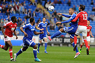 Cardiff's Kenneth Zohore (2nd right) challenges Nottingham's Daniel Fox (13) in the air. EFL Skybet championship match, Cardiff city v Nottingham Forest at the Cardiff City Stadium in Cardiff, South Wales on Easter Monday 17th April 2017.<br /> pic by Carl Robertson, Andrew Orchard sports photography.