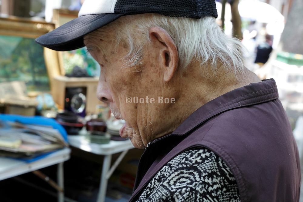 side view portrait of a elderly Japanese man
