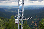 A mobile phone mast located at the cablecar station in Velika Planina, on 26th June 2018, in Velika Planina, near Kamnik, Slovenia. Velika Planina is a mountain plateau in the Kamnik–Savinja Alps - a 5.8 square kilometres area 1,500 metres (4,900 feet) above sea level. Otherwise known as The Big Pasture Plateau, Velika Planina is a winter skiing destination and hiking route in summer. The herders' huts became popular in the early 1930s as holiday cabins (known as bajtarstvo) but these were were destroyed by the Germans during WW2 and rebuilt right afterwards by Vlasto Kopac in the summer of 1945.