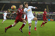 Tom Carroll of Swansea city holds off Andrew Robertson of Liverpool (l). Premier league match, Swansea city v Liverpool at the Liberty Stadium in Swansea, South Wales on Monday 22nd January 2018. <br /> pic by  Andrew Orchard, Andrew Orchard sports photography.