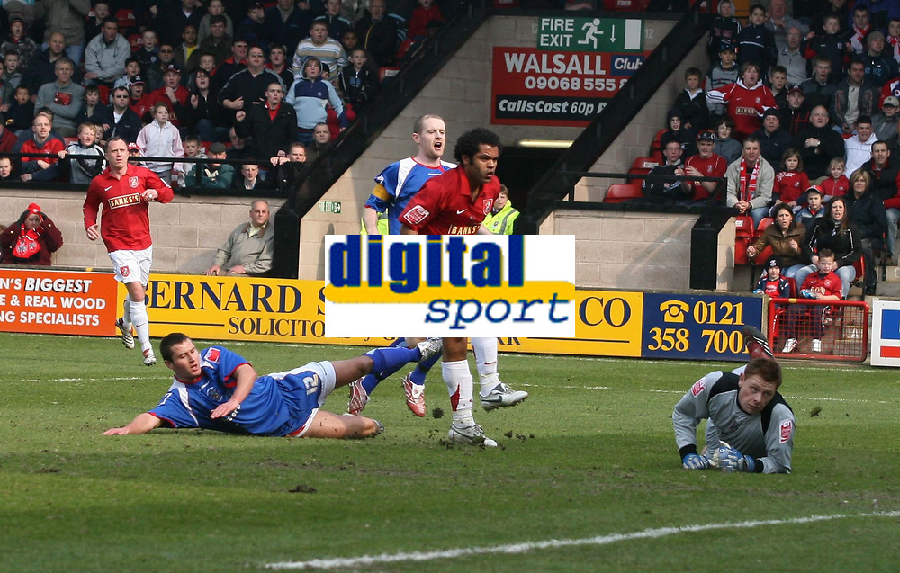 Photo: Mark Stephenson.<br />Walsall v Accrington Stanley. Coca Cola League 2. 31/03/2007. Walsall's Kevin Harper beats Accrington's keeper David Martin to score the first goal
