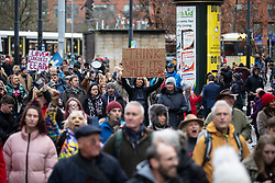 © Licensed to London News Pictures. 12/12/2020. Manchester, UK. Crowd marches through Manchester with with signs for North Unites protest in Piccadilly Gardens, Manchester. Piers Corbyn is expected to make a speech later. Photo credit: Kerry Elsworth/LNP
