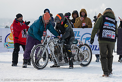 Moscow based world champion custom bike builder Dima Golubchikov with his pilot ready to race his twin-500cc Jawa engine all-aluminum, methanol fueled, land speed racer at the Baikal Mile Ice Speed Festival. Maksimiha, Siberia, Russia. Thursday, February 27, 2020. Photography ©2020 Michael Lichter.