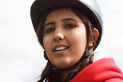 Portrait of woman with visual impairment  at riding lesson.