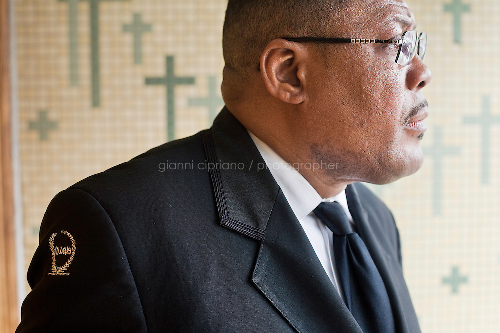 Harlem, New York, USA - February 23. Funeral home director Isaiah Owens waits for the end of the funeral service of Jeanette Marie Mayfield (sunrise Nov. 8 1965, sunset Feb. 18 2008) outside the Shiloh Baptist Church on February 23, 2008 in Harlem, New York, USA.