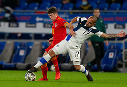 CARDIFF, WALES - Wednesday, November 18, 2020: Wales' Daniel James (L) is tackled by Finland's Nikolai Alho during the UEFA Nations League Group Stage League B Group 4 match between Wales and Finland at the Cardiff City Stadium. Wales won 3-1 and finished top of Group 4, winning promotion to League A. (Pic by David Rawcliffe/Propaganda)
