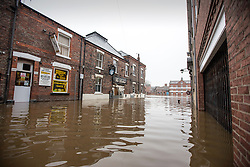© Licensed to London News Pictures. 07/12/2015. York UK. Picture shows the Loather pub in York that has flooded for the second time this month after the river Ouse in the city burst it banks last night with the after effects of Storm Desmond. Photo credit: Andrew McCaren/LNP