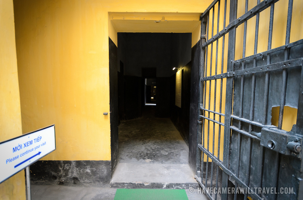 A gated doorway and dark corridor at Hoa Lo Prison. Hoa Lo Prison, also known sarcastically as the Hanoi Hilton during the Vietnam War, was originally a French colonial prison for political prisoners and then a North Vietnamese prison for prisoners of war. It is especially famous for being the jail used for American pilots shot down during the Vietnam War.