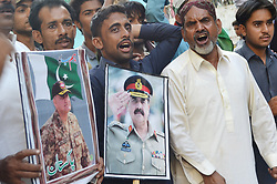 September 6, 2017 - Hyderabad, Sindh, Pakistan - Members of City Welfare holds the play card of former and present Army chief of Pakistan during the protest in favor of Burma Muslims out side Hyderabad Press Club (Credit Image: © Janali Laghari/Pacific Press via ZUMA Wire)