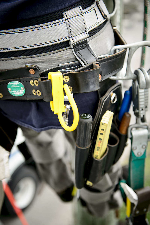 Detail of a construction workers tool belt.