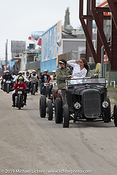 Mel Stultz and Sara Francello lead bikes and cars onto the beach for day two of racing at TROG (The Race Of Gentlemen) in Wildwood, NJ. USA. Sunday June 10, 2018. Photography ©2018 Michael Lichter.