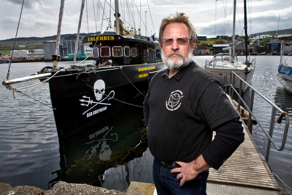 Torshavn Harbor, Streymoy Island, Faroe Islands.<br />  <br /> Scott West, a member of Sea Shepherd for over 20 years, heads up Sea Shepherd's land operations in Operation Grindstop 2014.  West, and American, was hired by SS in 2008; taking early retirement from his role as the Special Agent-in-Charge of the Criminal Investigation Division for the Seattle Area Office of the United States Environmental Protection Agency (EPA).  West also served as the Special Agent-in-Charge of the EPA Criminal Investigation Division Area Offices in Washington, DC and San Francisco.<br /> <br /> Mr. West heads up Sea Shepherd's Department of Intelligence and Investigations.<br /> <br /> Scott West in Torshavn Harbor in front of the Sea Shepherd boat, The Columbus.