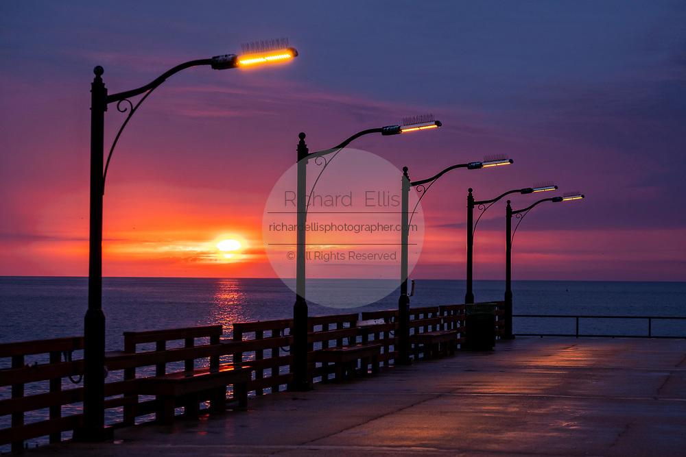 The St. Simons Public Pier at sunrise along the Saint Simons Sound in St. Simons Island, Georgia.