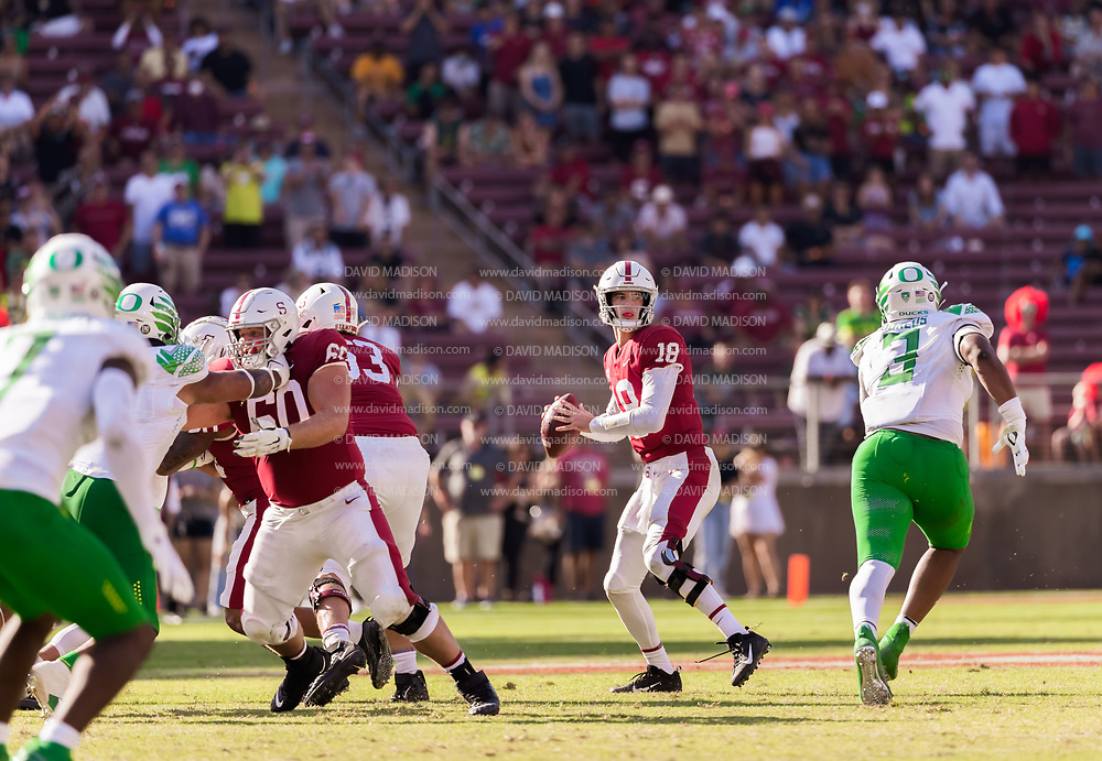 PALO ALTO, CA - OCTOBER 2:  Tanner McKee #18 of the Stanford Cardinal attempts a pass during an NCAA Pac-12 college football game against the Oregon Ducks on October 2, 2021 at Stanford Stadium in Palo Alto, California.  (Photo by David Madison/Getty Images)