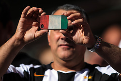 5 August 2017 -  Pre-Season Friendly - Tottenham Hotspur v Juventus - A Juventus fan holding an iPhone featuring a cover in the style of the Italian flag - Photo: Marc Atkins / Offside.