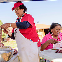 Isabelle Wilson, left, and Margaret James slice mutton and make traditional achii during a sheep butchering and barbecue at Red Rock Care Center in Gallup Friday.