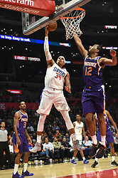 November 28, 2018 - Los Angeles, CA, U.S. - LOS ANGELES, CA - NOVEMBER 28: Los Angeles Clippers Forward Tobias Harris (34) goes up for a shot around Phoenix Suns Forward TJ Warren (12) during an NBA game between the Phoenix Suns and the Los Angeles Clippers on November 28, 2018, at STAPLES Center in Los Angeles, CA. (Photo by Chris Williams/Icon Sportswire) (Credit Image: © Chris Williams/Icon SMI via ZUMA Press)