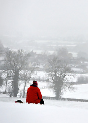 © Licensed to London News Pictures. 05/02/2012, Chinnor, UK.A woman takes in the view.  People enjoy the snow in Chinnor, Oxfordshire today 05/02/12.  Heavy snow has fallen over many parts of the UK overnight. Photo credit : Stephen Simpson/LNP
