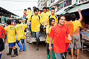 Oct. 6, 2009 -- SAMUT SAKHON, THAILAND: Burmese men return to their tenements in Samut Sakhon, Thailand after working an overnight shift in a fishing processing plant in the town, Oct. 6. The Thai fishing industry is heavily reliant on Burmese and Cambodian migrants. Burmese migrants crew many of the fishing boats that sail out of Samut Sakhon and staff many of the fish processing plants in Samut Sakhon, about 45 miles south of Bangkok. Migrants pay as much $700 (US) each to be smuggled from the Burmese border to Samut Sakhon for jobs that pay less than $5.00 (US) per day.   Photo by Jack Kurtz / ZUMA Press