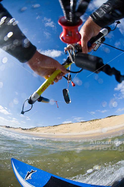 First person point of view kiteboarding with kite lines and bar with board visible. Kiteboarding downwinder, on Cape Cod wide open easter beaches