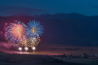 The Big Horn fireworks display is seen with Blacktooth Mountain in the background.