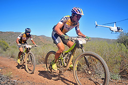 ROBERTSON, SOUTH AFRICA - MARCH 20: Yellow Jersey wearers Henrique Avancini and Manuel Fumic during stage two's 110km from Robertson on March 20, 2018 in Cape Town, South Africa. Mountain bikers from across South Africa and internationally gather to compete in the 2018 ABSA Cape Epic, racing 8 days and 658km across the Western Cape with an accumulated 13 530m of climbing ascent, often referred to as the 'untamed race' the Cape Epic is said to be the toughest mountain bike event in the world. (Photo by Dino Lloyd)